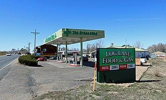 Log Lane Village, Colorado - A gas station in Log Lane Village.