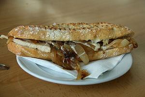 Bocadillo - Bocadillo prepared with pork fillet and fried onions and covered in alioli.