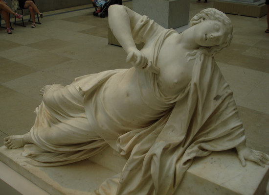 Marble statue of Lucretia committing suicide after her rape, by 18th century French sculptor Philippe Bertrand. In the collection of the Metropolitan Museum of Art.