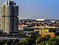 München, der BMW Vierzylinder und die Allianz Arena (9333541757).jpg