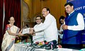 M. Venkaiah Naidu presenting the certificates for Credit Linked Subsidy Scheme (CLSS) under Pradhan Mantri Awas Yojana (URBAN) to home-loan beneficiaries, at a joint press conference, in Mumbai.jpg