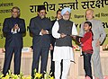 Manmohan Singh presented the National Painting Competition Prizes, at the National Energy Conservation Day function, in New Delhi. The Union Power Minister, Shri Sushil Kumar Shinde and the Minister of State for Power.jpg