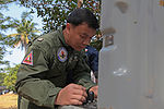 Marine Wing Support Squadron 172 and Royal Thai Air Force explosive ordnance disposal train together during Cobra Gold 2011 DVIDS365913.jpg