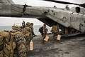 Marines board a CH-53E Super Stallion on the flight deck of USS Kearsarge. (37285072132).jpg