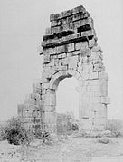 Photograph showing a standing fragment of a wall of the basilica in 1887