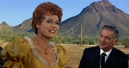 https://upload.wikimedia.org/wikipedia/commons/thumb/b/bb/Maureen_O%27Hara-Robert_Lowery_in_McLintock%21.jpg/450px-Maureen_O%27Hara-Robert_Lowery_in_McLintock%21.jpg