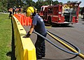 Members of the Naval Air Station Meridian Fire Department fill temporary barriers with water in preparation for Hurricane Isaac at Naval Air Station Meridian, Miss., Aug. 27, 2012 120827-N-WJ771-017.jpg