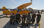 Members of the New Jersey Civil Air Patrol pose with a new friend at the Power in the Pines Open House and Air Show.jpg