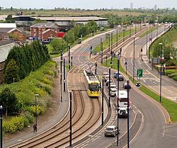 Metrolink Tram on Lord Sheldon Way, 4479802 David Dixon.jpg