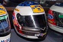 Photo d'un casque de course blanc et bleu sur le dessus