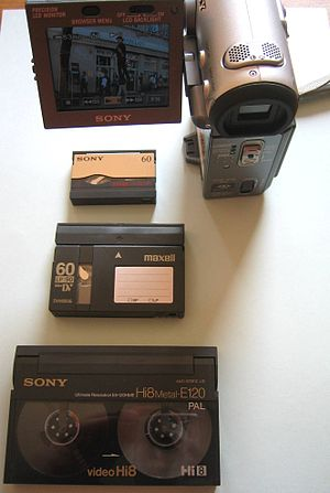 MicroMV - MicroMV camcorder and tape (top) compared to miniDV and Hi8 tapes