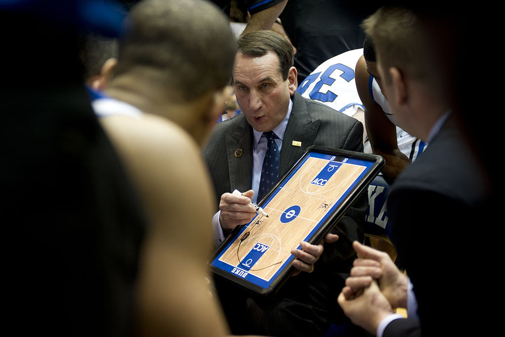Mike Krzyzewski talks to his team during a timeout