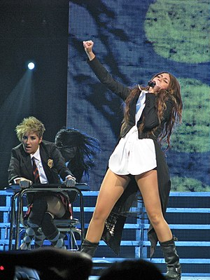 "Breakout (Miley Cyrus album) - Cyrus performing ""Simple Song"" on the Wonder World Tour"