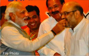 Amit Shah - Modi congratulates Amit Shah as he becomes BJP President