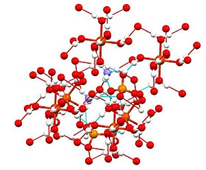 Ammonium iron(II) sulfate - Structure of ferrous ammonium sulfate with hydrogen bonding network highlighted  (N is violet, O is red; S is orange, Fe = large red).