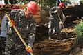 Mongolian Armed Forces Pvt. Otgonbayar Nabag, left, and U.S. Army Staff Sgt. Matthew Zawel, with the 176th Engineer Company, 96th Troop Command, Washington Army National Guard, dig and flatten a trench during 130723-M-DR618-059.jpg