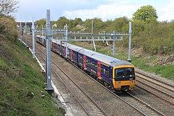 Moulsford - fGWR 166203 up train on main line.JPG