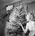 Mrs Devereux and her daughter celebrate Christmas at their home in Pinner, Middlesex, 1944. D23008.jpg
