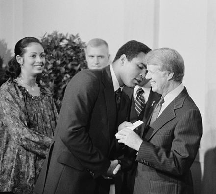 President Jimmy Carter greets Ali at a White House dinner, 1977. Muhammad Ali and Jimmy Carter.jpg