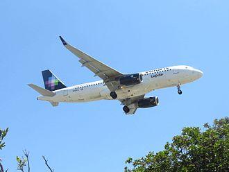 Volaris - A Volaris A320 landing at Los Angeles International Airport.