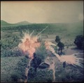 Napalm bombs explode on Viet Cong structures south of Saigon in the Republic of Vietnam. - NARA - 542328.tif