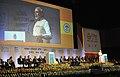 "Narendra Modi addressing the gathering at the ""Invest Madhya Pradesh - Global Investors Summit 2014"", at Indore, Madhya Pradesh. The Chief Minister of Madhya Pradesh, Shri Shivraj Singh Chouhan is also seen (1).jpg"