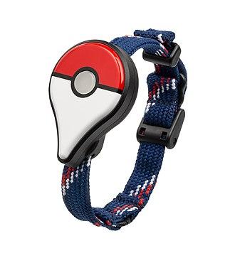 Pokémon Go - The Pokémon Go Plus, shown with wrist strap