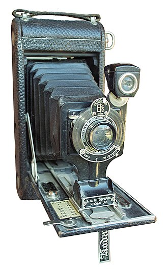 F-number -  A 1922 Kodak with aperture marked in U.S. stops.  An f-number conversion chart has been added by the user.