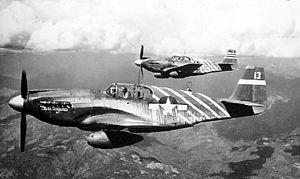 Philip Cochran - Philip Cochran in his P-51A (background) over Burma.