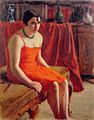 O Connor seated woman in a red dress.jpg