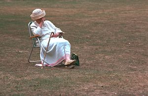 Older woman with straw hat relaxing, seen in E...