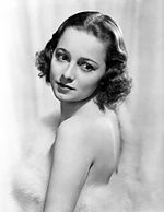 Zwart-wit publiciteitsfoto van Olivia de Havilland in 1938.
