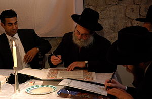 Ketubah - Rabbi filling in the final details of a ketubah