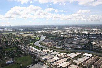 An aerial view of Greater Western Sydney: As well as being mostly suburban in nature, western Sydney is also made up of various industrial precincts and business parks Parramatta River aerial Rosehill.jpg