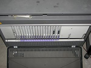 Business telephone system - An Avaya G3si PBX with front cover removed (view from the top)