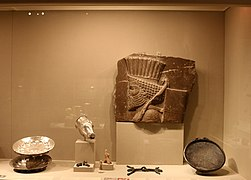 Museum display case showing Achaemenid objects.