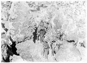 Phosphate mining in Nauru - Chinese phosphate workers on Nauru standing between limestone pinnacles