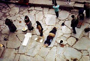 Prostration (Buddhism) - Pilgrims prostrating at the Jokhang, Lhasa