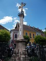 Plague cross. Baroque, 1763. Late Rococo.Wrought-iron fence. Tripod-like base. Three red marble spiral volutes. Column trunk with carving. - Szentendre, Fő Square.JPG