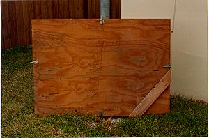 Hurricane shutter - A hurricane shutter made out of plywood.