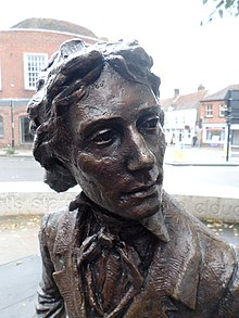 john keats  sculpture of poet john keats seated on bench by vincent gray chichester west sussex uk 2017