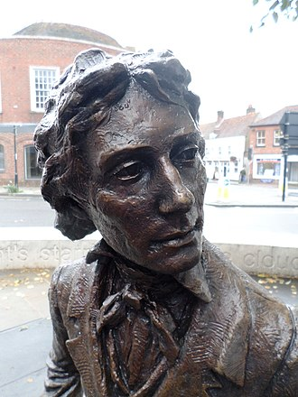 Sculpture of poet John Keats (seated on bench) by Vincent Gray - Chichester, West Sussex, UK. August 2017 Poet John Keats, by sculptor Vincent Gray.jpg