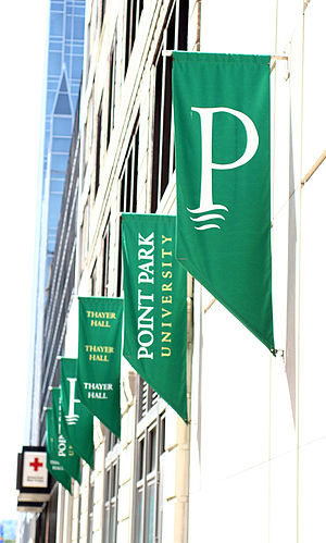 Point Park University flags line the campus in...