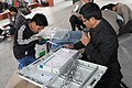 Polling officers checking the Electronic Voting Machines (EVM`s) and other necessary imputes required for the Assembly Election, in Assam on April 03, 2011.jpg