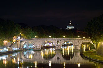 Ponte Sisto - The bridge at night with Saint Peter's dome in background