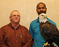 Posing for picture with Bald Eagle. (10594320905).jpg