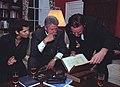 President Bill Clinton and musician Bono look at a book.jpg