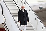 Prime Minister Narendra Modi coming out of Air India One after landing at Heathrow airport, London.jpg