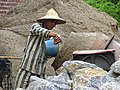 Prisoner at Cement Mixer on Construction Site - Dien Bien Phu - Vietnam (48168738646).jpg