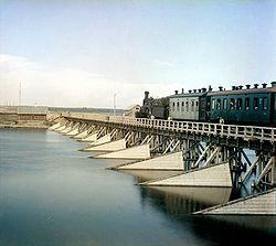 Early 20th-century photo of a bridge across the Shuya River